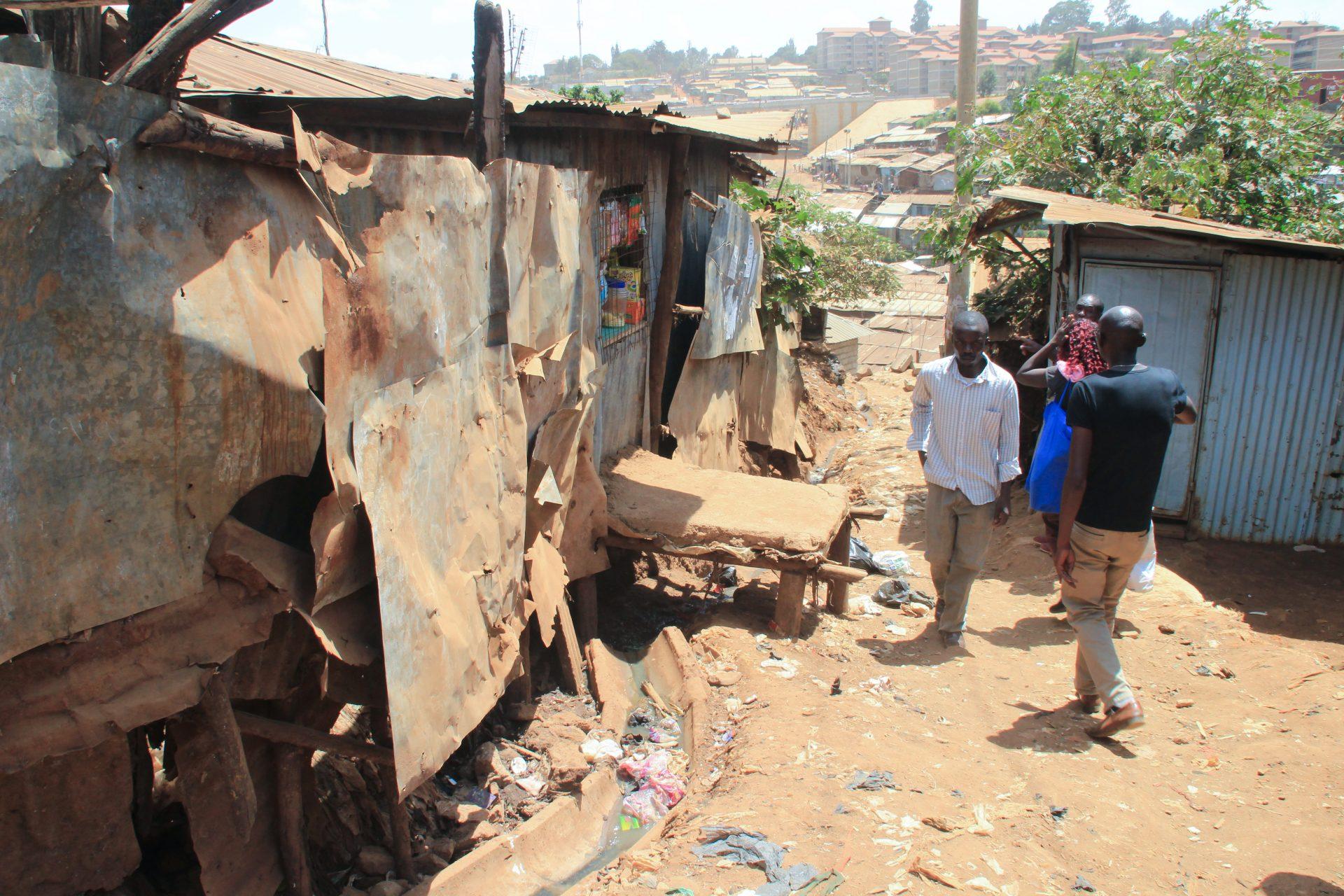 Kibera, Nairobi, Kenya - February 13, 2015: a street in slums with poor huts